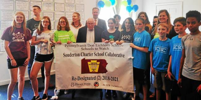 Students, teachers, and guests of honor with Schools to Watch banner